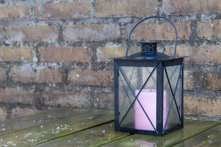 Wet lamp for candles in a garden