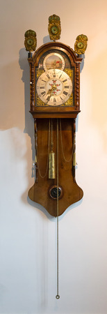Brass weight on an old dutch clock - Selective focus