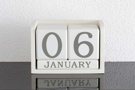 White block calendar present date 6 and month January on white wall background