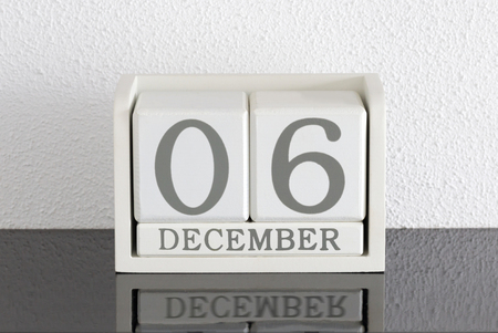White block calendar present date 6 and month December on white wall background Stock fotó