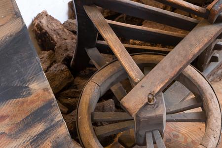 Old wheel on a wheelbarrow, selective focus