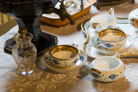 Set of teapots and old tea cups on the table - The Netherlands Stock Photo