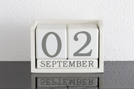 White block calendar present date 3 and month September on white wall background Stock Photo