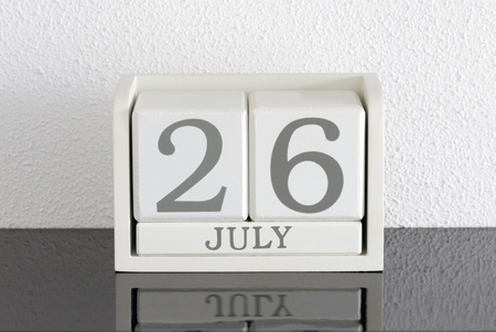 White block calendar present date 26 and month July on white wall background Stock Photo