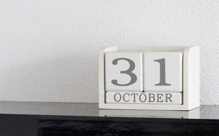 White block calendar present date 31 and month October on white wall background