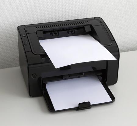 Compact laser home printer on a white desk