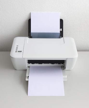 Compact home printer on a white desk Stock Photo