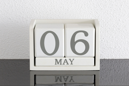 White block calendar present date 6 and month May on white wall background Stock fotó