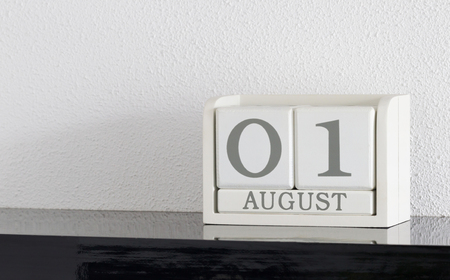 White block calendar present date 1 and month August on white wall background Banque d'images