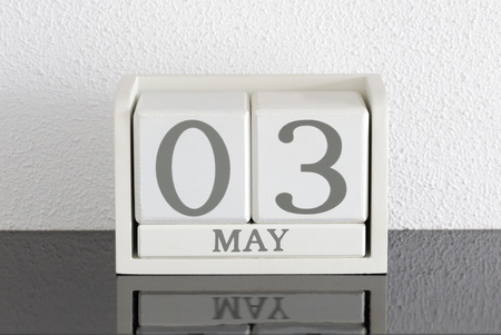 White block calendar present date 3 and month May on white wall background
