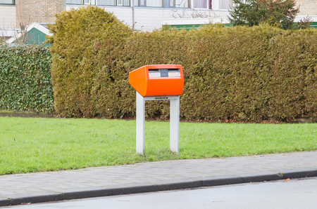 Posting a letter in the Netherlands - Orange letterbox Banque d'images