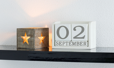 White block calendar present date 3 and month September on white wall background Banque d'images
