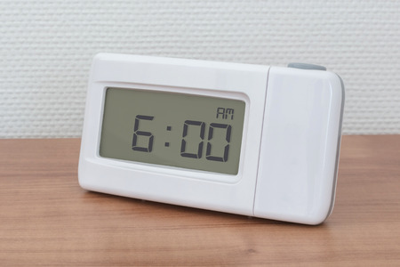 Clock radio on a desk - Time - 06.00 AM