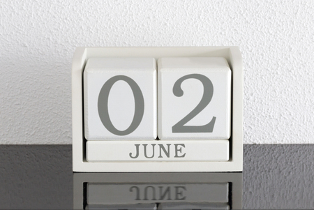 White block calendar present date 3 and month June on white wall background Banque d'images