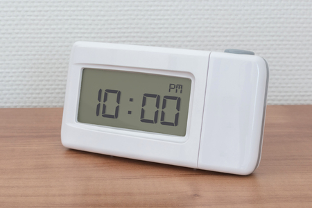 Clock radio on a desk - Time - 10.00 PM