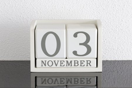 White block calendar present date 3 and month November on white wall background