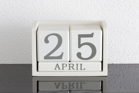 White block calendar present date 25 and month April on white wall background Banque d'images