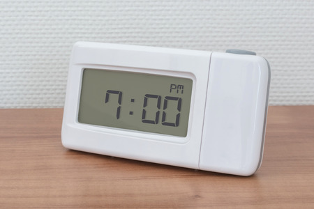 Clock radio on a desk - Time - 07.00 PM Stock Photo