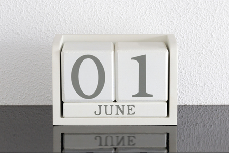 White block calendar present date 1 and month June on white wall background