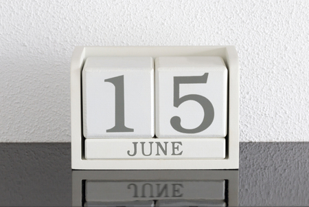White block calendar present date 15 and month June on white wall background Stock Photo