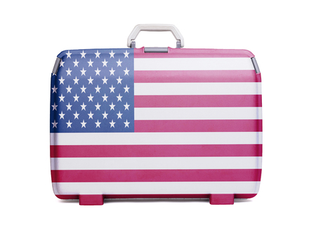Used plastic suitcase with stains and scratches, printed with flag, United States of America