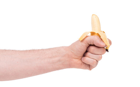 Small tropical banana in a hand, isolated on white Stock Photo