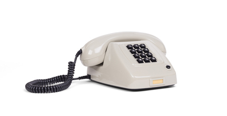 Vintage grey telephone with a white background