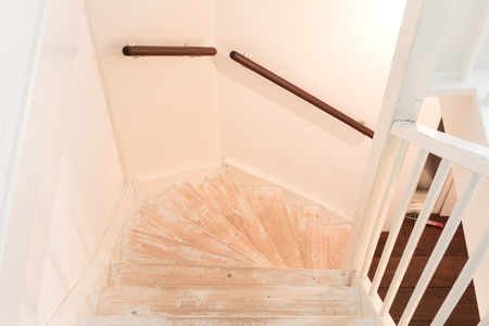 Removing carpet, glue and paint from an vintage stairs - Selective focus Stock Photo
