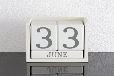 White block calendar present date 33 and month June on white wall background - Extra day