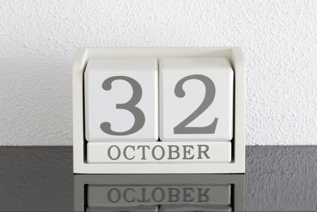 White block calendar present date 32 and month October on white wall background - Extra day