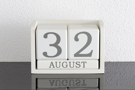 White block calendar present date 32 and month August on white wall background - Extra day