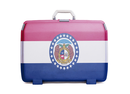 Used plastic suitcase with stains and scratches, printed with flag, Missouri
