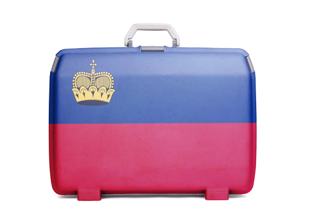 Used plastic suitcase with stains and scratches, printed with flag, Liechtenstein
