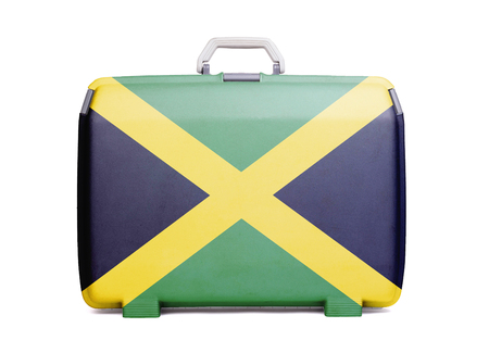 Used plastic suitcase with stains and scratches, printed with flag, Jamaica