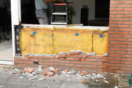 Breaking up a brick wall - Remodeling a house