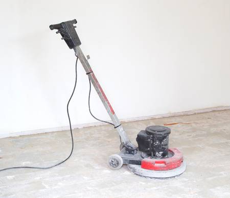Construction business concept : Concrete surface sanding machine : Workers use concrete sanding machine to smooth the cement floor. Stock Photo