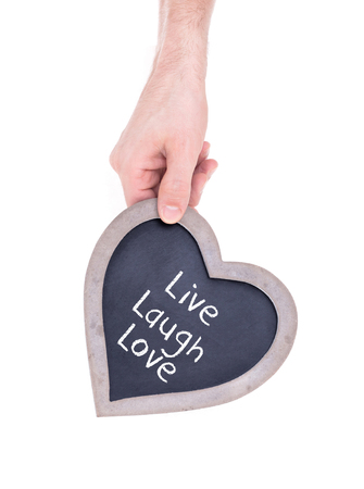 Adult holding heart shaped chalkboard - Isolated on white - Live laugh love