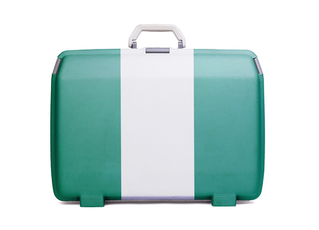 Used plastic suitcase with stains and scratches, printed with flag, Nigeria