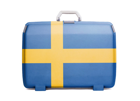 Used plastic suitcase with stains and scratches, printed with flag, Sweden