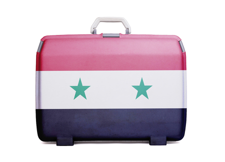 Used plastic suitcase with stains and scratches, printed with flag, Syria
