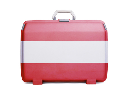 Used plastic suitcase with stains and scratches, printed with flag, Austria Stock Photo