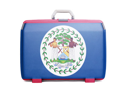Used plastic suitcase with stains and scratches, printed with flag, Belize Stock Photo