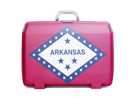 Used plastic suitcase with stains and scratches, printed with flag, Arkansas