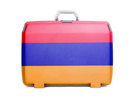 Used plastic suitcase with stains and scratches, printed with flag, Armenia