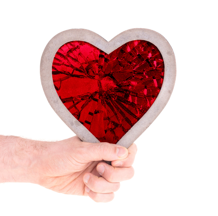 Adult holding heart filled with a large red ruby - Isolated on white