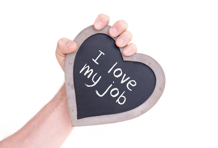 Adult holding heart shaped chalkboard - Isolated on white - Love my job Stock Photo