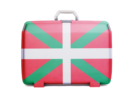 Used plastic suitcase with stains and scratches, printed with flag - Basque Country