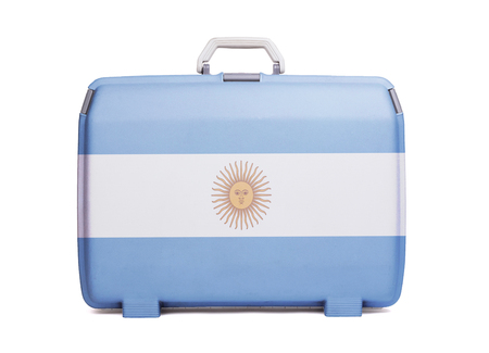 Used plastic suitcase with stains and scratches, printed with flag, Argentina