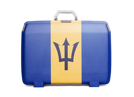 Used plastic suitcase with stains and scratches, printed with flag, Barbados Stock Photo
