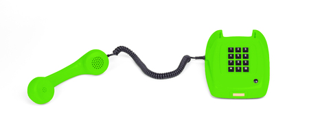 Vintage white telephone with a green background